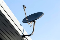Satellite dish on a sky background for football television