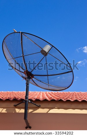 Satellite dish on house roof