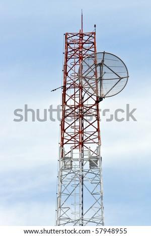 Satellite Dish on Telecommunication Radio antenna Tower with blue sky - stock photo
