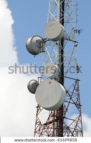 Satellite Dish on Telecommunication Radio antenna Tower with blue sky