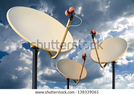 Satellite dish on the blue sky with cloud.