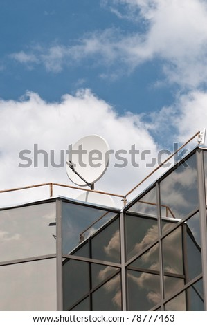Satellite dish on the modern building roof  with blue sky in the background