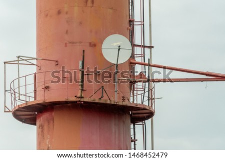 Satellite dish telecoms on telecommunications tower on white clear sky, and copy space