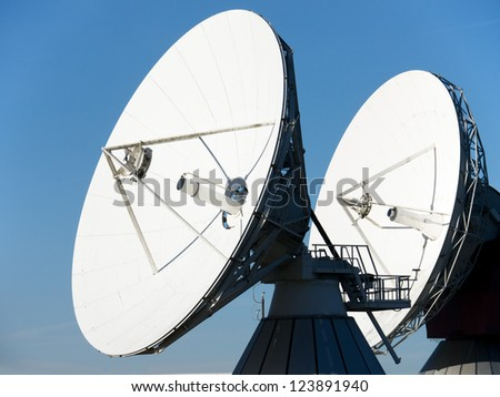 satellite dishes at a meadow near munich - germany