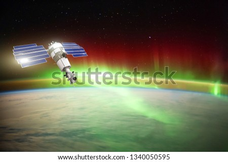 Satellite for observing aurora borealis in Earth orbit, measuring the flow of sun particles, the solar wind. Elements of this image furnished by NASA