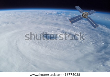 Satellite In Orbit over Earth with Hurricane - stock photo