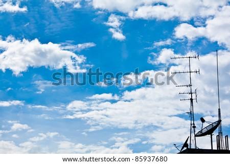 Satellite  on blue sky - stock photo