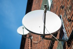 satellite tv antenna on a residential building