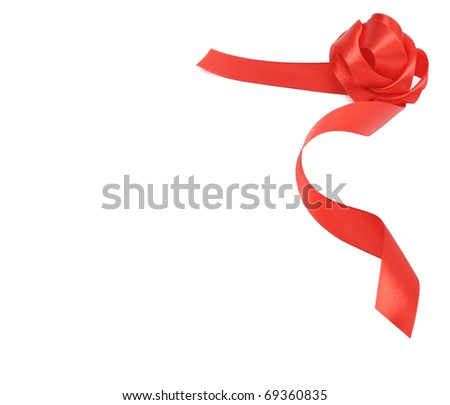 Satin red ribbon bow on white background with copy space.