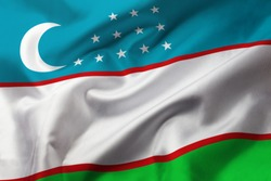 Satin texture of curved flag of Uzbekistan