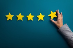 Satisfaction concept. Woman hand giving five star rating on green background, copy space