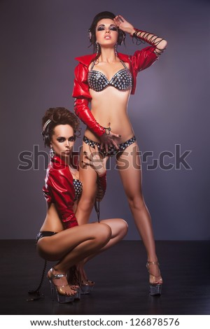 Satisfaction. Lust. Sultry Women Lover in Provocative Pose