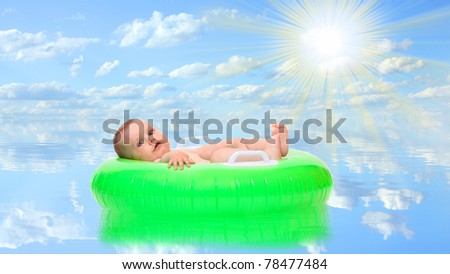 Satisfied baby in a rubber dinghy floating on a water level. Conceptual image - insurance business metaphor.