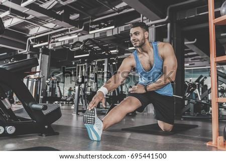 Satisfied bearded athlete taking physical exercise Stock photo ©