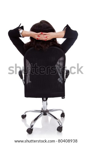 Satisfied business woman with hands crossed behind her head