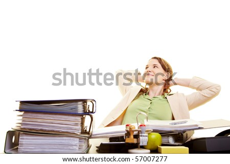 Satisfied businesswoman at her desk leaning back