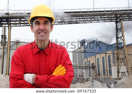Satisfied industrial worker in a factory