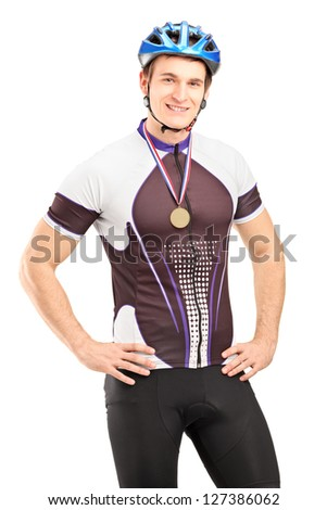 Satisfied male cyclist winner posing with a golden medal isolated on white background