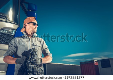 Satisfied Truck Driver Finished His Latest Cargo. Transportation Theme with Copy Space. #1192551277