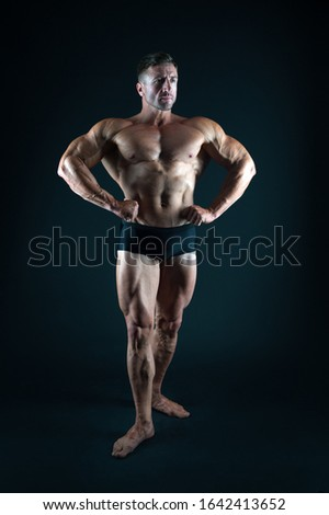 Satisfied with result of trainings. Perfect shape. Bodybuilder concept. Bodybuilder man strong body. Bodybuilder six packs. Sexy bodybuilder muscular torso. Bodybuilding sport. Power of muscles.