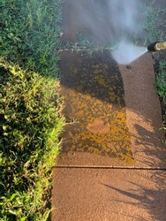 Satisfying concrete pressure washing job that can be used to promote pressure washing business
