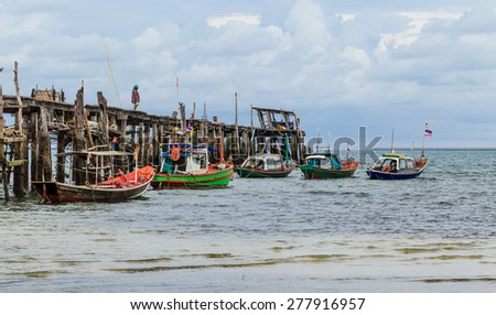 SATTAHEEP CHONBURI - MAY,14 : Fishing boats stand in the harbor To transport fish from the boat to the market. They are preparing supply and food before go out to the sea. THAILAND MAY,14 2015