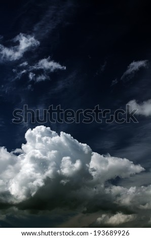 Saturated storm clouds against the dark sky.