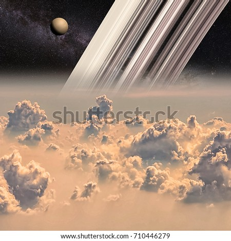 Saturn and the moon Titan viewed from the clouds