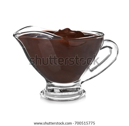 Sauce boat with delicious melted chocolate on white background #700515775