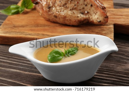 Sauce boat with tasty turkey gravy on table Сток-фото ©