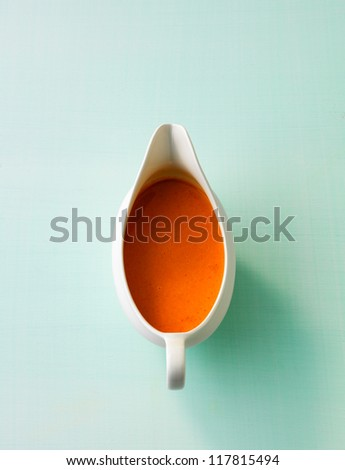 Sauce boat with tomato sauce