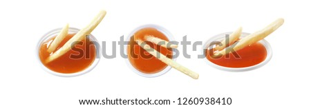 sauce french fries, french fries in small chili sauce cup, set of french fries and chili sauce cup (isolated on white background) #1260938410