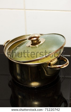 saucepan on electric stove with pasta in boiling water