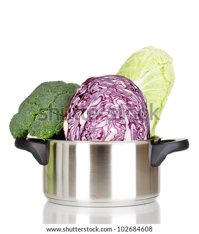 Saucepan with cabbages and broccoli isolated on white - stock photo