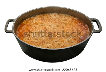 Saucepan with pilaw on a white background - stock photo