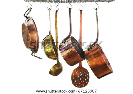 saucepans hanging from a rack in a traditional style kitchen