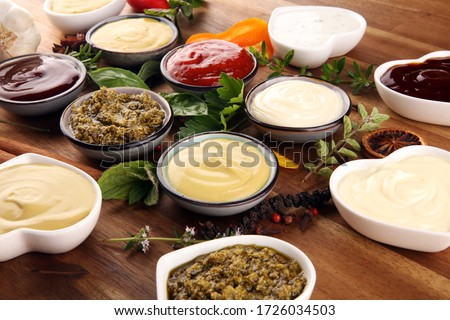 Sauces Assortment. Set of various sauces in bowls with ketchup, mayonnaise, pesto and mustard Stockfoto ©