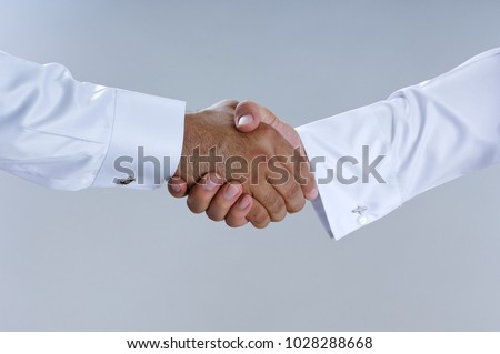 Saudi Arab Businessmen Hands Shaking, Making Agreement and Welcoming Closeup