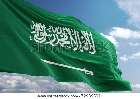 Saudi Arabia big realistic national flag waving in blue sky