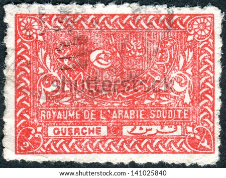 SAUDI ARABIA - CIRCA 1943: Postage stamp printed in Saudi Arabia shows the Tughra of King Abdul Aziz, circa 1943