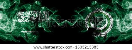 Saudi Arabia Kingdom vs Arab League smoky mystic flags placed side by side. Thick colored silky smoke flags of Arabic, Arabian and Arab League #1503213383