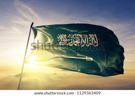 Saudi Arabia national flag textile cloth fabric waving on the top
