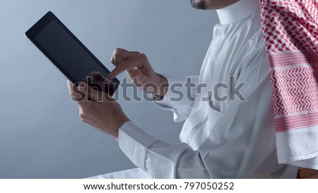 Saudi Arabian Man Hands Holding and Using Tablet