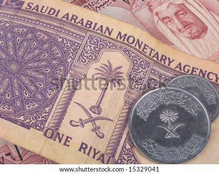 Saudi Arabian riyal banknotes and coins