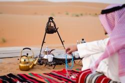 Saudi Man Sitting in Desert  (Bar)
