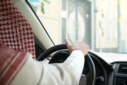 Saudi men waiting in his car.