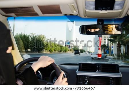 Saudi Woman Driving a Car in Saudi Arabia