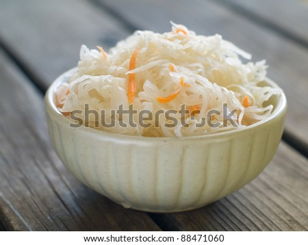 Sauerkraut with carrot in bowl, selective focus