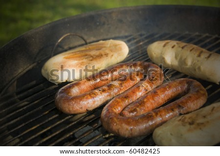 Sausage and bread rolls on the BBQ