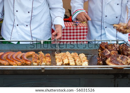 sausage on a large barbecue outdoor - stock photo
